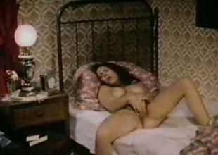 Sexy busty unlit woman masturbates and fucks