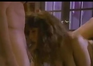 Christy Canyon in a engulfs FMM scene