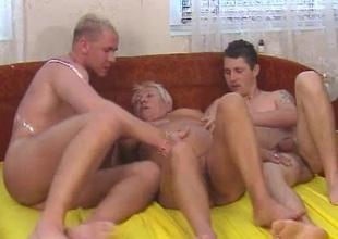 Chesty light-haired granny enjoys threesome fucking
