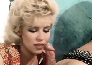 Buxomy blond devouring shaft in classic vintage porn