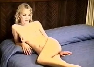 Kris Posing On The Bed Showing Her Muted Snatch