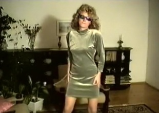 70's curly blonde retro girl strips and dances in the living section