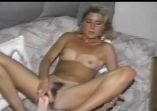 Cute vintage blonde regarding tan lines toy fucks her cunt