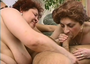 Two mature ladies inveigle a young stud to bring their sexual fantasies to fruition