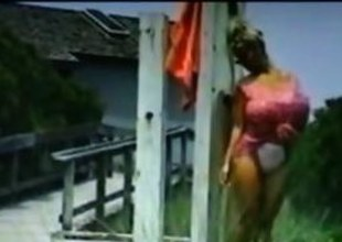 Gigantic jugs blonde stunner in arms washes herself outside